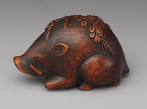 03 - Netsuke Boar resting on bush clover, 19th century, Japanese, Wood (91.1.989)